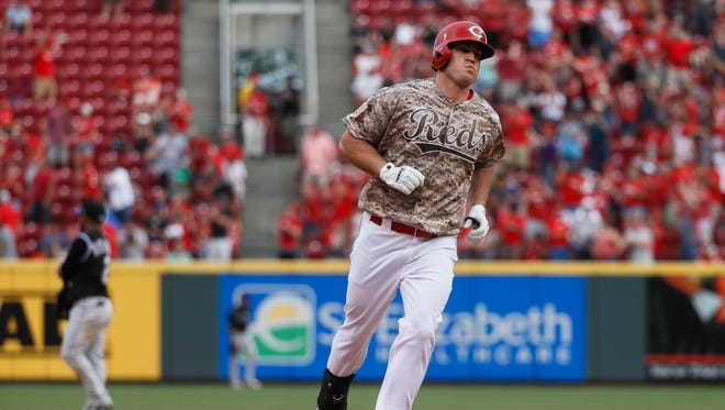Cincinnati Reds' Scott Schebler runs the bases after hitting a go-ahead three-run home run off Colorado Rockies relief pitcher Mike Dunn in the sixth inning of a baseball game, Saturday, May 20, 2017, in Cincinnati. (AP Photo/John Minchillo)