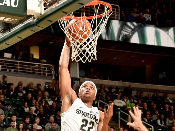 Spartan freshman Miles Bridges (22) goes high for a