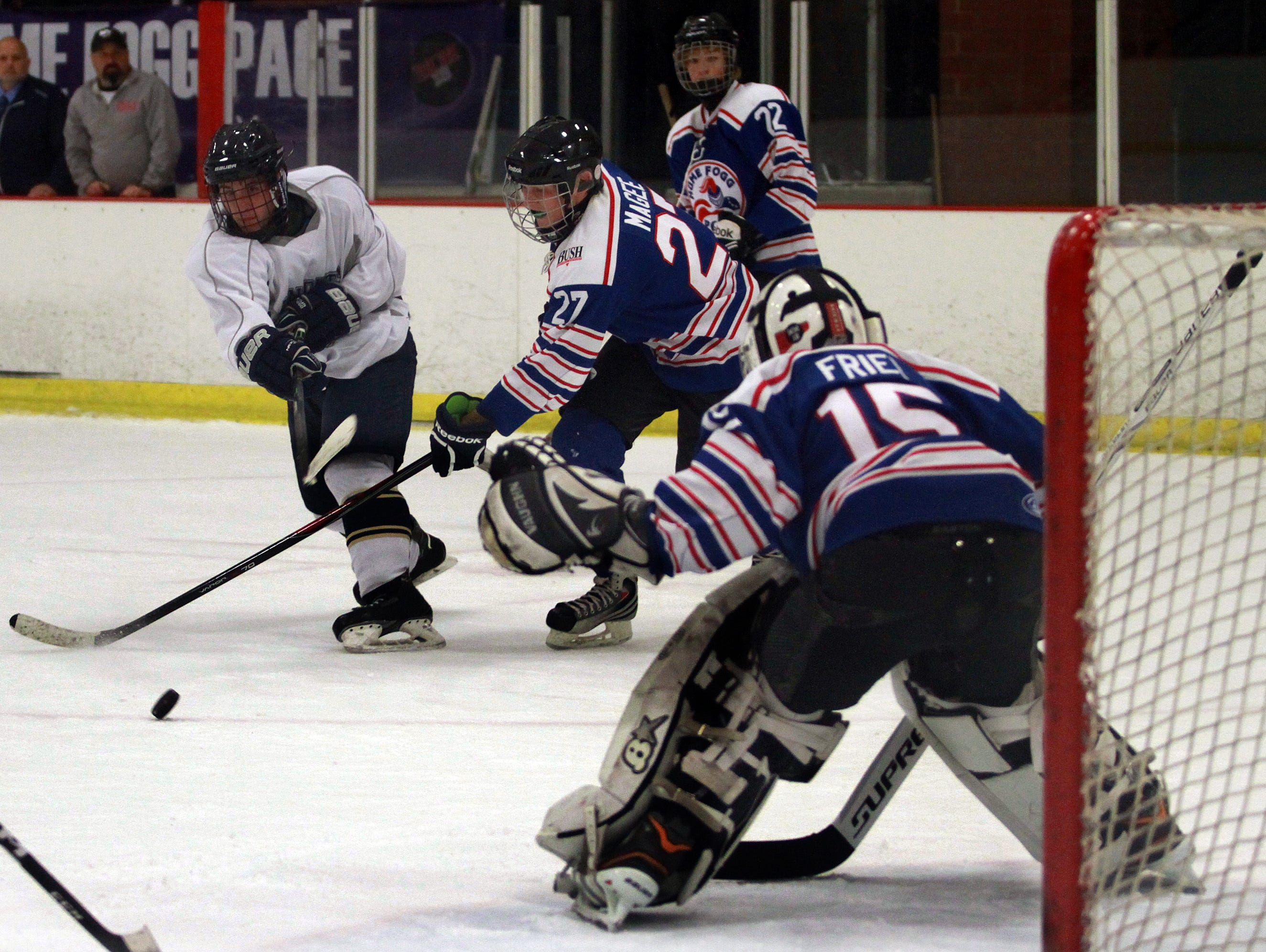 Pope John Paul II's Kenner Lycans fires on Hume-Fogg/Page goalie Grant Friel during Wednesday's game.
