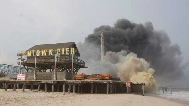A fire that started at the Kohr's ice cream stand on the south end of Seaside Park's Funtown Pier spreads north on Sept. 12, 2013. The owner of Funtown Pier wants to bring new giant rides and dune buggies to the beach.