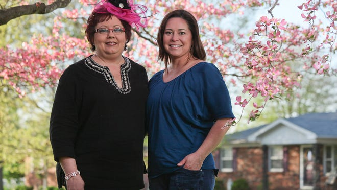 Breast cancer survivor Tammi Poole, left, wears a fascinator designed by Monica Young, right, for the Kentucky Oaks. It will be part of Poole's pink ensemble for the Survivors Parade at Churchill Downs.