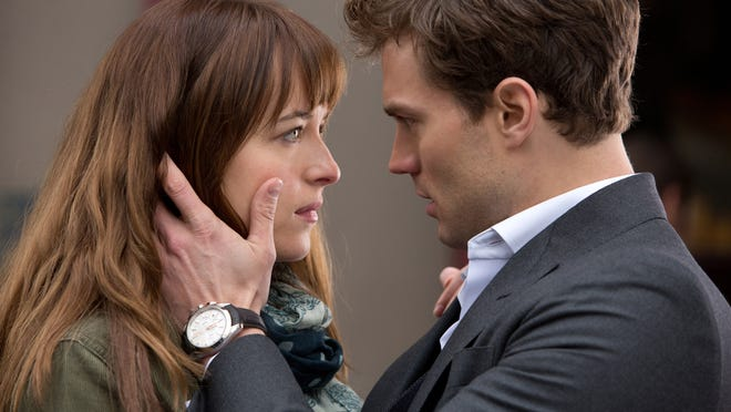 "AP Dakota Johnson and Jamie Dornan appear in a scene from ""Fifty Shades of Grey."" In this image released by Universal Pictures and Focus Features, Dakota Johnson, left, and Jamie Dornan appear in a scene from ""Fifty Shades of Grey."" (AP Photo/Universal Pictures and Focus Features)"