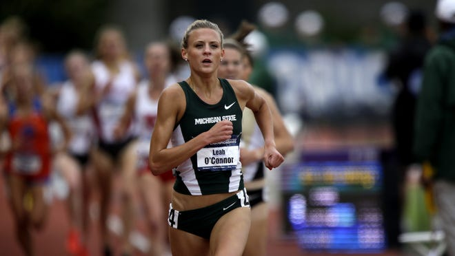 Michigan State's Leah O'Connor races to the finish line during the women's 3000 meter steeplechase at the NCAA track and field championships Friday, June 13, 2014, in Eugene, Ore. O'Connor won the race. (AP Photo/Rick Bowmer)