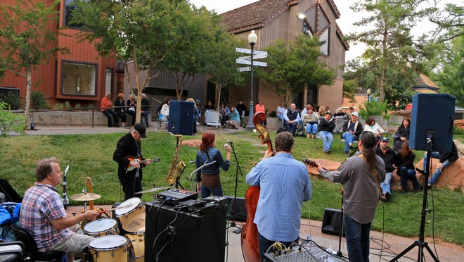 Beans & Wheels perform at Ancestor Square as part of a weekly concert series offered in the spring and fall by the Southern Utah Song Writers Association. St. George is proposing a new downtown district that would allow businesses to apply for tax incentives in exchange for new development.