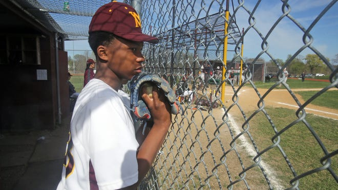 Mount Vernon High School baseball player Shawn Harris watches the action from the dugout during a game against White Plains at Mount Vernon High School in April.
