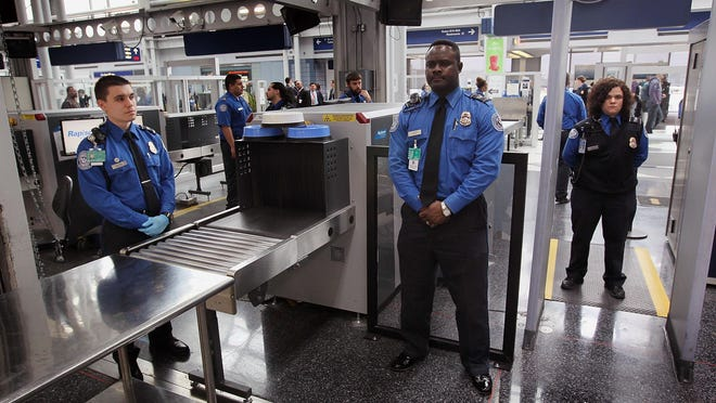 Transportation Security Administration officers staff a checkpoint at O'Hare International Airport.