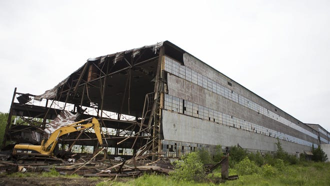Work begins to demolish the Odenbach Shipyard building in Greece on Thursday.