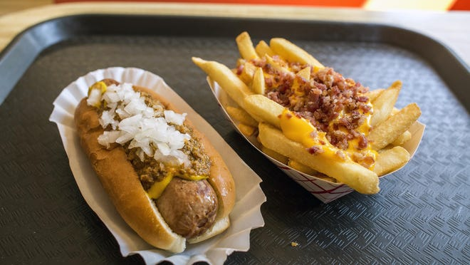 The all-beef jumbo hot dog with chili, mustard and onions and the bacon cheese fries are two of the many options for classic American fare at Hot Dog World.