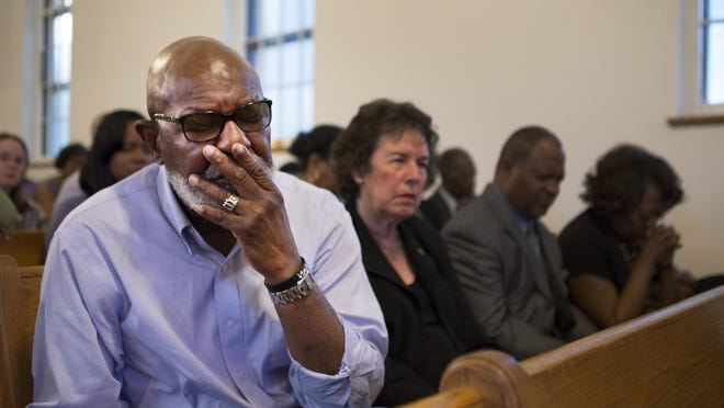 Joe Brown becomes emotional during a vigil for the victims of the Charleston shooting at Baber AME Church in Rochester on Thursday. Brown was vice president of the Rochester NAACP when the Rev. Norvel Goff was president. Goff is to assume leadership of the South Carolina church where Wednesday's tragedy occurred.