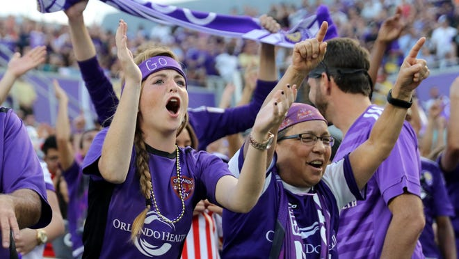 Orlando City Soccer fans cheer on the team during a recent home game.