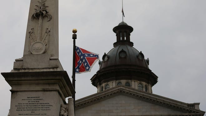 The Confederate flag flies on the Capitol grounds in Columbia, S.C., after Gov. Nikki Haley announced June 22 that she will call for the flag to be removed.