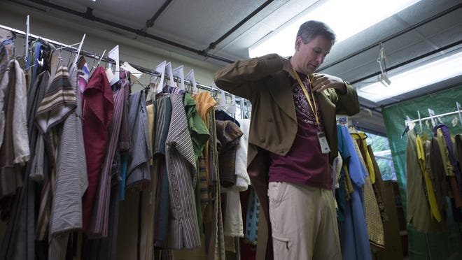 Christian Hancey of Pittsford tries on his coat in the costume room for the Hill Cumorah Pageant on Thursday, July 9, 2015. He has been cast to portray Joseph Smith, the founder of Mormonism.