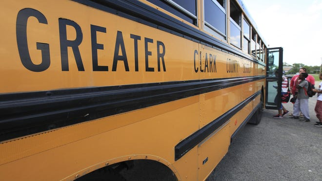 A Greater Clark County school bus picks up students at Spring Hill Elementary School in May.