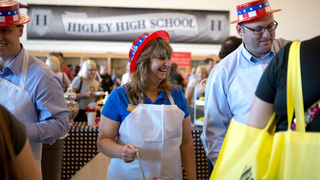 Governing Board Member Jake Hoffman, far left, Vice President Kristina Reese and Board Member Russell Little serve ice cream to teachers during the Higley Unified School District's Welcome Back Rally on July 21. Classes began in the district Monday.
