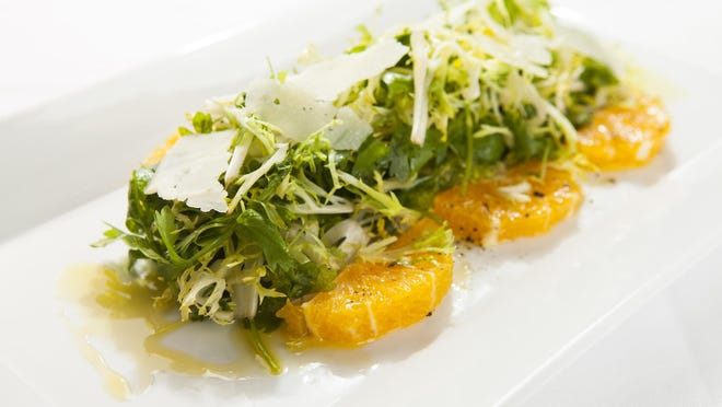 An orange frisee salad is light and tasty.