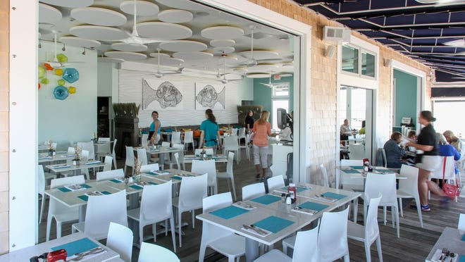 The dining room at Avon Pavilion looks over the beach.