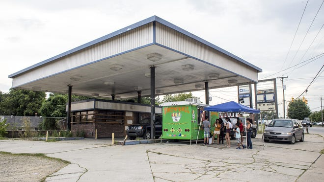 "Patrons line up for treats from the Snowball shaved ice truck on Haywood Road on Wednesday. Owner Josue Guzman pulls his trailer to the abandoned gas station in West Asheville most days and serves up Mexican-style ""raspados"" with fresh fruit and ice."