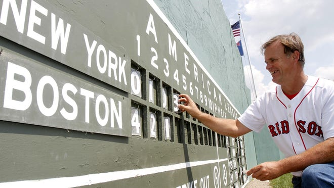 Essex's Pat O'Connor changes the scoreboard at Little Fenway, a scaled-down version of the major league field in 2010.