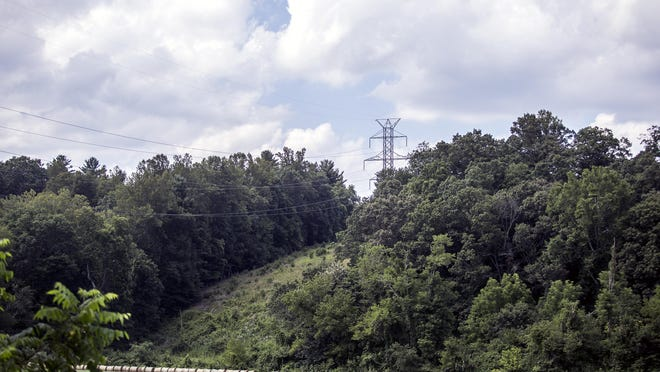 Existing Duke Energy power lines hang over pasture and mountains in Mills River feeding power to Asheville. Duke Energy is proposing running new power lines up from South Carolina through the Mills River area to provide even more energy to the growing area.