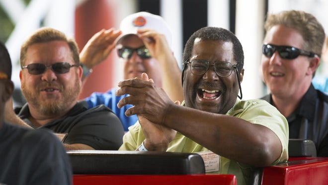 American Coaster Enthusiast Michael Burkess of Akron, Ohio, laughs while applauding after riding the Jack Rabbit.
