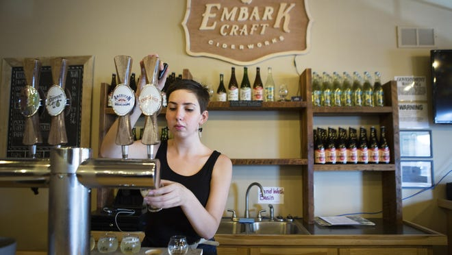 Beth Gillis pours a flight of ciders in the taproom of Embark Craft Ciderworks at Lagoner Farms.