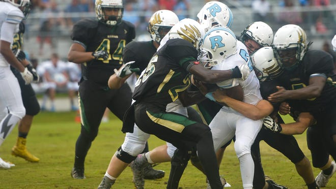 Viera's defense stops a play during the first half against Rockledge.