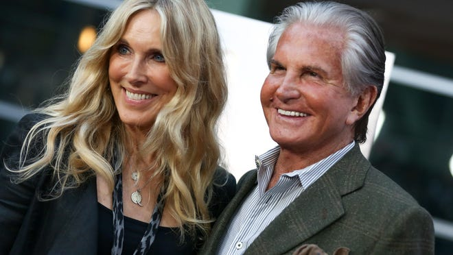 """Alana Stewart, left, and George Hamilton are seen here arriving at the LA Premiere of """"Being Evel"""" on Aug. 19, 2015, in Los Angeles. The two will also be seen in Palm Springs in an upcoming episode of """"Stewarts & Hamiltons"""" on E!"""