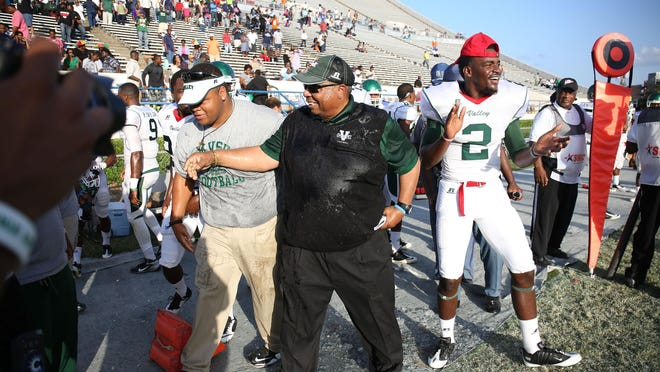 Mississippi Valley players celebrate with coach Rick Comegy after their win against Jackson State. It was a long-awaited victory and one of the few bright spots in the 2014 season.