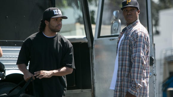 "O'Shea Jackson Jr., left, stars as Ice Cube and Corey Hawkins as Dr. Dre in ""Straight Outta Compton,"" the top film in theaters for a third weekend in a row."