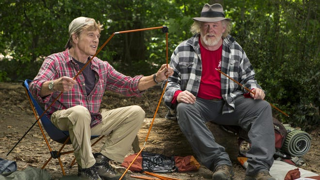"Robert Redford, left, as Bill Bryson and Nick Nolte as Stephen Katz hike the Appalachian Trail in ""A Walk in the Woods."""