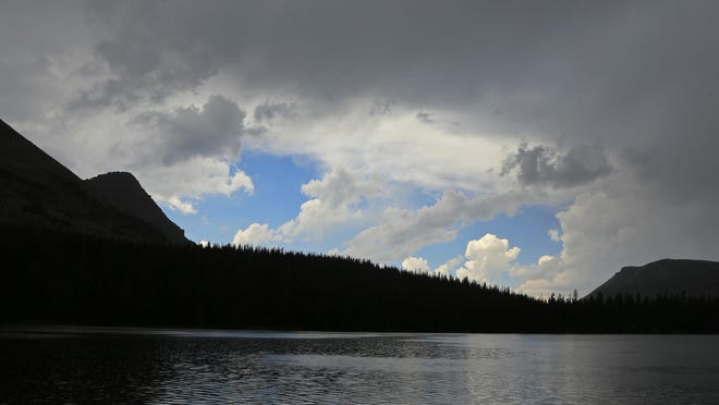 Storm clouds gather around Mirror Lake in the Uinta Mountains. Survival in the Uinta Mountains can be difficult because of the rapidly changing weather conditions.