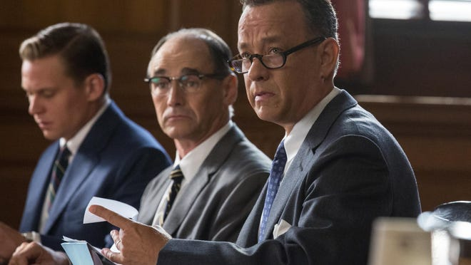 """In this image released by Disney, Tom Hanks, from right, Mark Rylance and Billy Magnusson appear in a scene from """"Bridge of Spies."""" (Jaap Buitendijk/DreamWorks Pictures/Fox 2000 PIctures via AP)"""