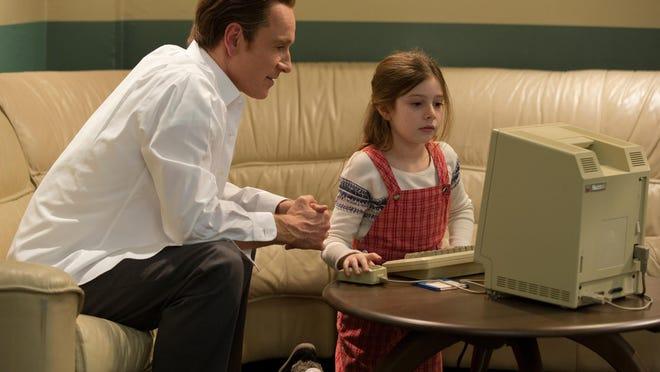 "Michael Fassbender, left, and Makenzie Moss appear in a scene from ""Steve Jobs."""