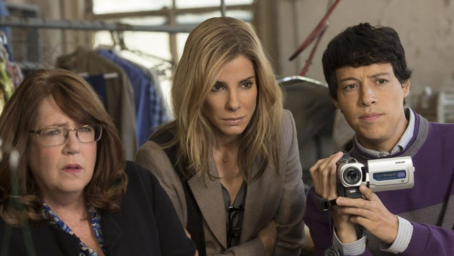 """From left: Ann Dowd, Sandra Bullock and Reynaldo Pacheco in """"Our Brand Is Crisis."""" a Warner Bros."""