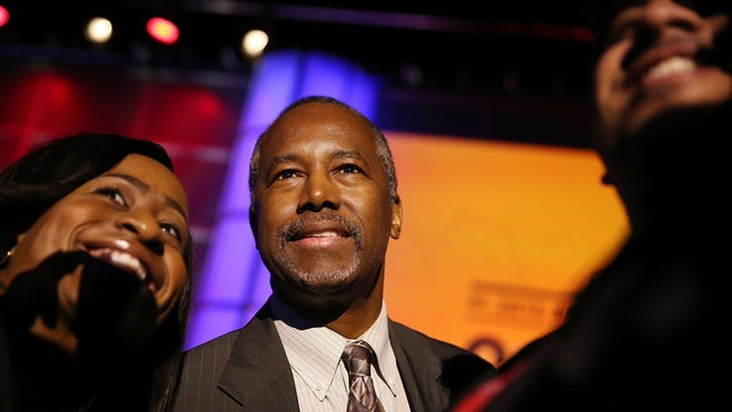 Republican Presidential hopeful Ben Carson greets people during the Presidential Candidates Plenary at the National Urban League conference in the Fort Lauderdale Convention Center on July 31 in Fort Lauderdale, Fla.