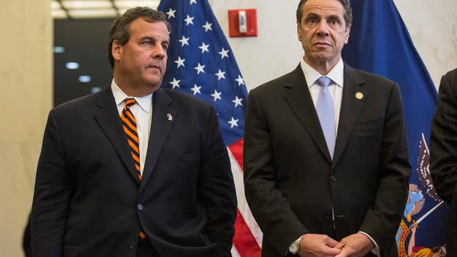 """New Jersey Gov. Chris Christie (left) and New York Gov. Andrew Cuomo in a file photograph. Christie is vying for the Republican nomination for president, in field where opposition to new gun control laws has been touted as a virtue, and he says President Barack Obama's new call to restrict access to assault weapons is """"absurd.'' But Christie didn't always feel this way. (Photo by Andrew Burt/Getty Images)"""