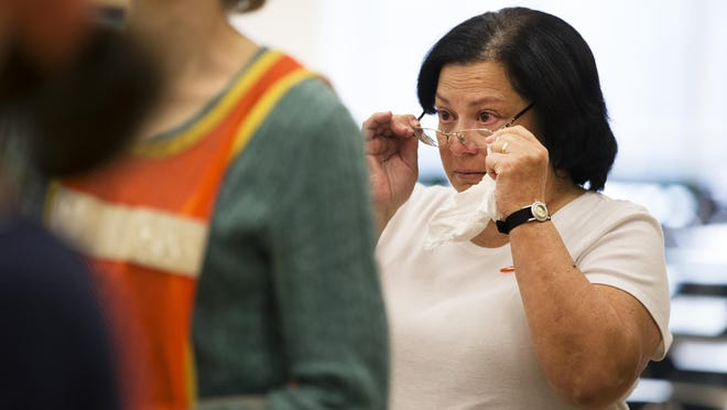 Mary Lou Bopp of Henrietta becomes emotional during a vigil held by Moms Demand Action for Gun Sense in America at Rush-Henrietta Senior High School on Sunday, Dec. 13, 2015. Monday, Dec. 14, marks the three-year anniversary of the mass shooting at Sandy Hook Elementary School in Newtown, Connecticut.