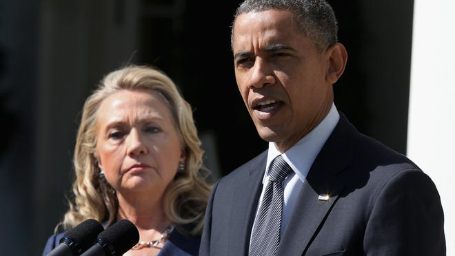 Then-Secretary of State Hillary Clinton and President Barack Obama make a statement about the death of U.S. ambassador to Libya J. Christopher Stevens at the White House on Sept. 12, 2012, after Stevens and three other embassy employees were killed in Benghazi.
