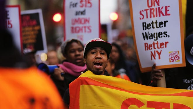 Minimum wage increases are set to take effect in more than a dozen states in 2016, but not New Jersey. Low wage workers and supporters protest for a $15 an hour minimum wage in New York. (Spencer Platt, Getty Images)