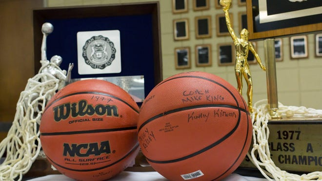 The trophies from Farmington Hills Mercy's 1977 and 1982 girls basketball state championships were on display Jan. 8 for a reunion of the two teams at the school.