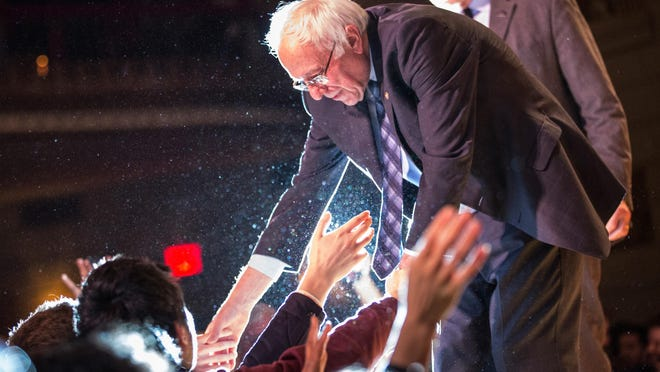 Democratic presidential candidate Sen. Bernie Sanders, I-Vt., shakes hands with supporters after outlining his plan to reform the U.S. financial sector on January 5, 2016, in New York City.