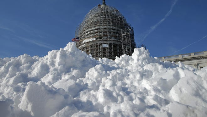 A pile of shoveled snow stands in the plaza on the east side of the U.S. Capitol January 21, 2016, in Washington, DC. Airports seeing at least 50 preemptive Friday cancellations as of late Thursday afternoon included Raleigh-Durham, Washington Reagan National, New York LaGuardia, Atlanta, Dallas/Fort Worth and Chicago Midway.
