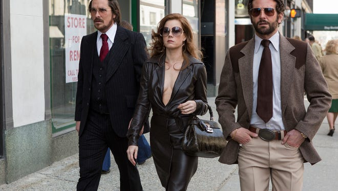 """Christian Bale, from left, Amy Adams and Bradley Cooper star in """"American Hustle."""" (AP Photo/Sony-Columbia Pictures)"""