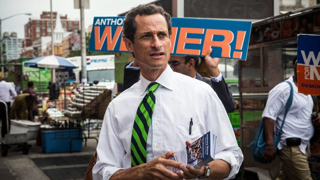 NEW YORK, NY - SEPTEMBER 10:  New York City mayoral hopeful Anthony Weiner meets with people on a street corner In Harlem on September 10, 2013 in New York City. Registered voters in New York are voting today in the Democratic and Republican primary races to nominate party candidates for the New York mayoral race.  (Photo by Andrew Burton/Getty Images) ORG XMIT: 180362154 ORIG FILE ID: 180218409