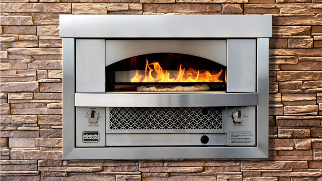 Kalamazoo Outdoor Gourmet released the built-in Artisan Fire Pizza Oven in 2015. Once it reaches 800°F, it can cook a Neapolitan-style pizza in fewer than three minutes.