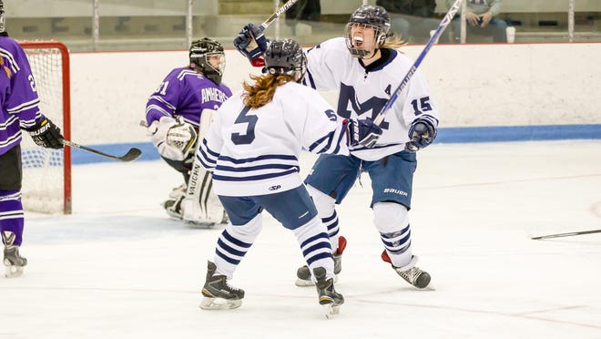 Middlebury's Katie Mandigo, right, and Shanna Hickman celebrating a goal in Sunday's NESCAC championship game. Mandigo scored two goals in the Panthers' 5-4 win over Amherst.