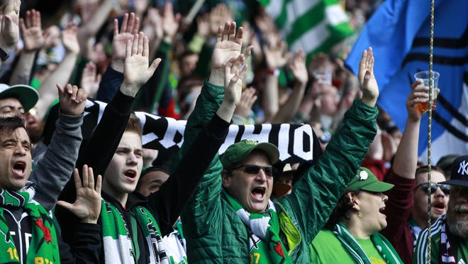Portland Timbers fans cheer before an MLS soccer match against the Columbus Crew in Portland, Ore., Sunday, March 6, 2016. (AP Photo/Steve Dipaola)