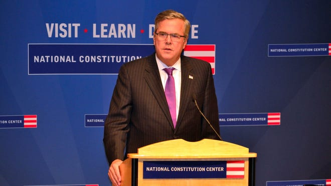Jeb Bush, the former Florida governor,  talks about his father, George H.W. Bush, at the preview of the new George H.W. Bush Gallery on Monday, Oct. 27, 2014.  Bush was speaking at the National Constitution Center in Philadelphia.  (AP Photo/Philadelphia Daily News, C.F. Sanchez) ORG XMIT: PAPHN101