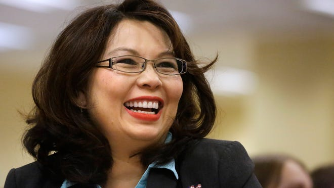 FILE - In this Aug. 13, 2014 file photo, U.S. Rep. Tammy Duckworth, D-Ill., appears at annual state fair Governor's Day brunch in Springfield, Ill. U.S. Sen. Mark Kirk, R-Ill., says the disability he suffers from his stroke has made him more known and more popular than ever, and that it will help him win re-election in 2016. Duckworth is among a number of Democrats considering a run to challenge Kirk. (AP Photo/Seth Perlman, File) ORG XMIT: CX801