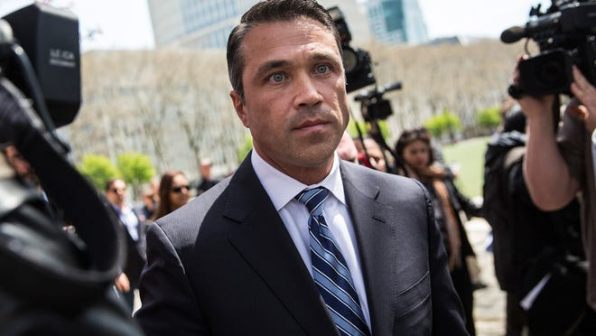 NEW YORK, NY - APRIL 28:  U.S. Representative Michael Grimm (R-NY, 11th District) leaves a press conference he spoke at after leaving Brooklyn Federal Court where he was indicted on 20 counts on April 28, 2014 in the Brooklyn borough of New York City. Grimm's indictments include wire fraud, mail fraud, conspiring to defraud the United States, impeding the Internal Revenue Service, hiring and employing unauthorized aliens, and health care fraud.  (Photo by Andrew Burton/Getty Images) *** BESTPIX ***